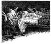Boy in bed in dormitory