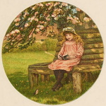 Little girl sitting and reading in the garden