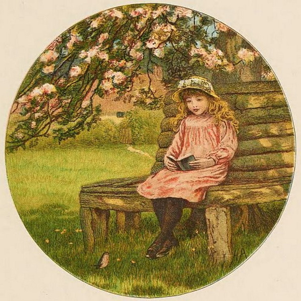 Little girl sitting and reading in the garden.jpg