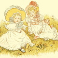 Two little girls sitting on the grass