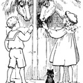 Boy and girl feeding the horses