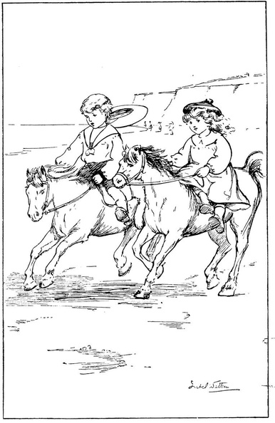 Two children riding ponies on the beach.jpg